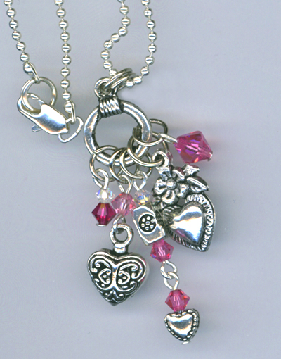pink multi crystal heart charm necklace